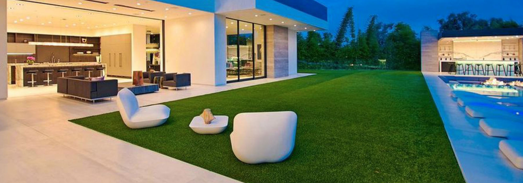 contemporary home with synthetic grass backyard