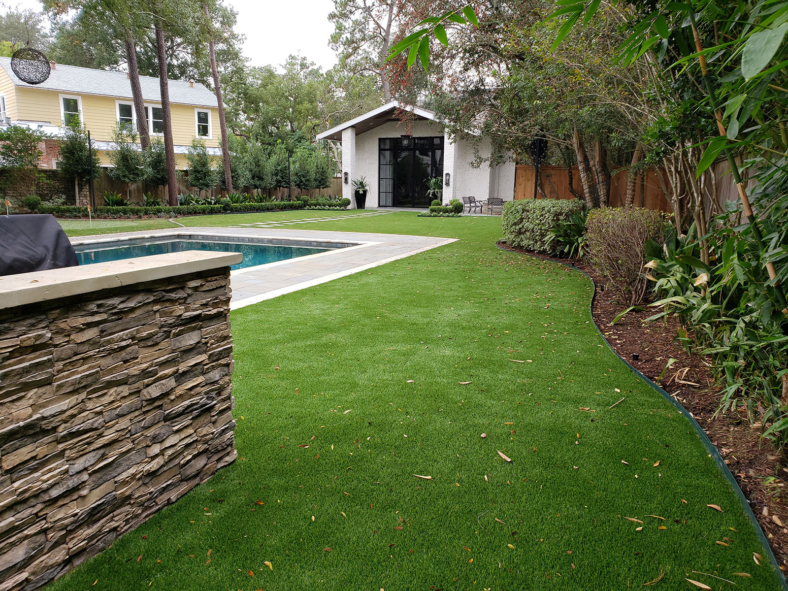 private backyard with synthetic turf lawn