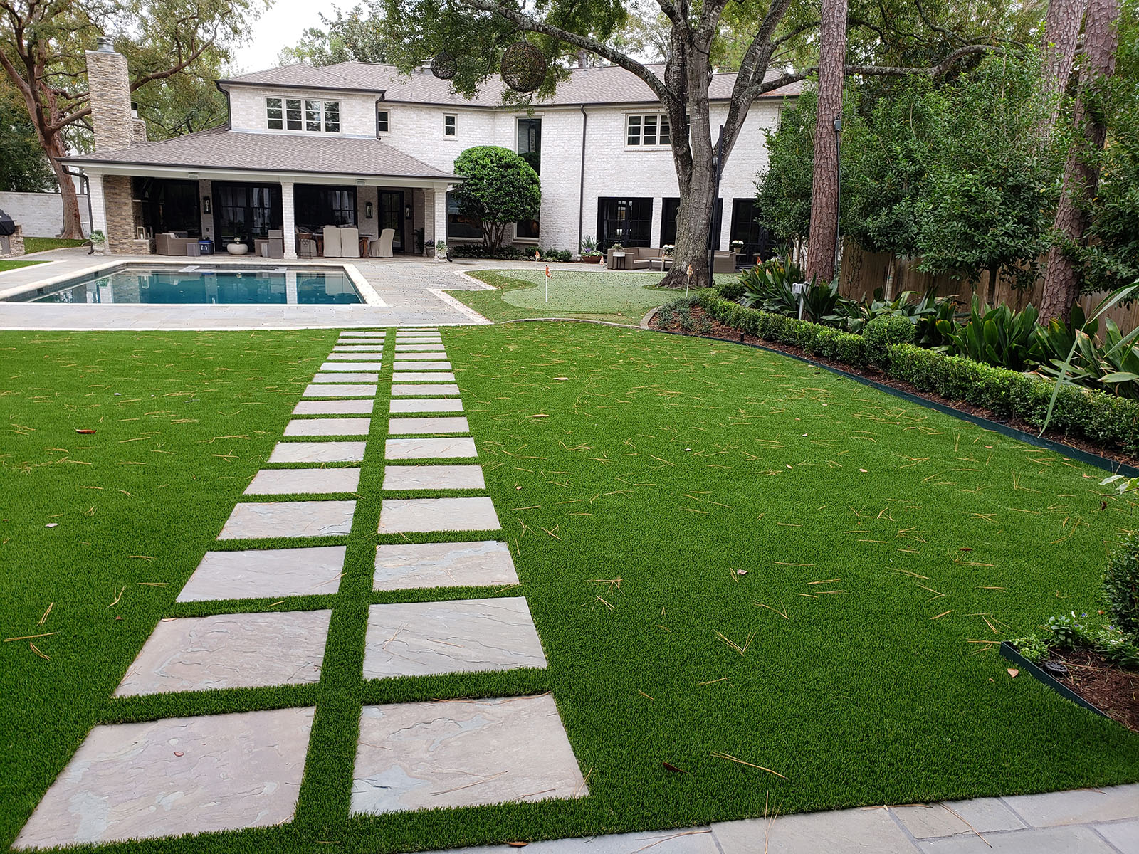 artificial grass lawn with pavers
