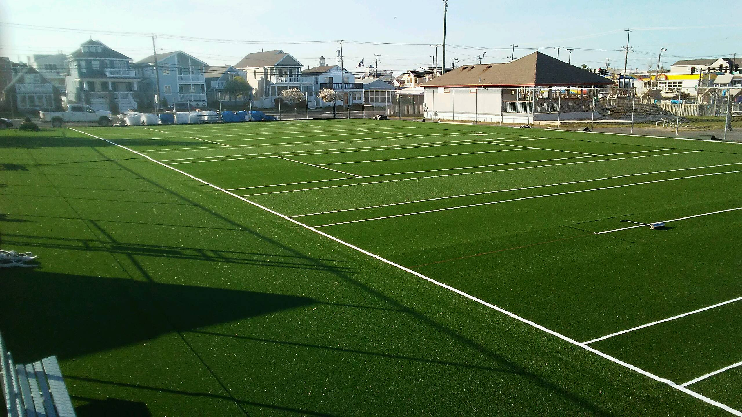 commercial tennis court complex with artificial turf