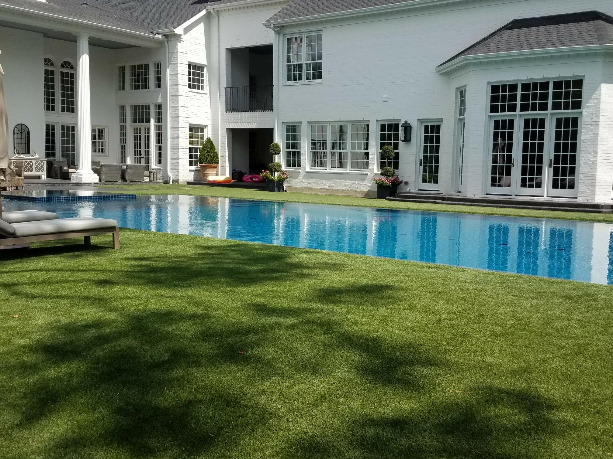 zero edge pool with artificial grass surround